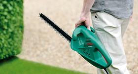 Электрический кусторез облегчает уход за садом и участком