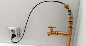 Греющий кабель спасает трубы от промерзания